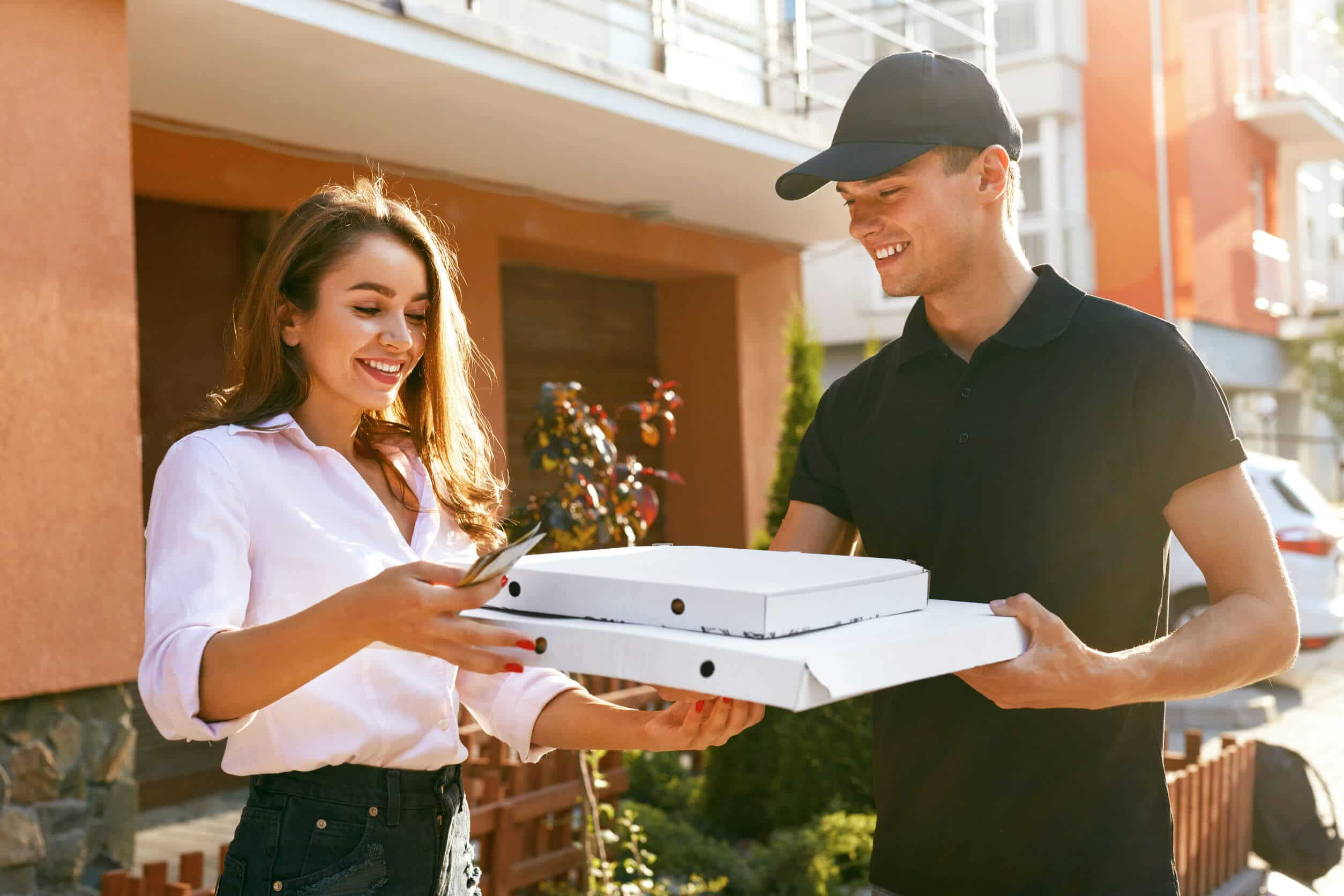 Pizza Delivery. Courier Giving Woman Boxes With Food Outdoors. Client Receiving Order. High Resolution